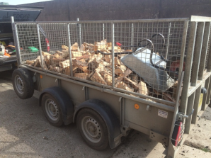 kiln dried logs on trailer